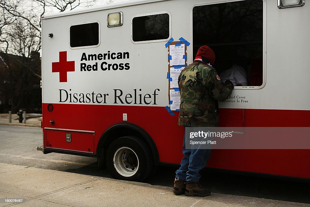 A man waits for food at the window of Red Cross Disaster Relief truck in the Rockaways following Hurricane Sandy on January 25, 2013 in the Queens borough of New York City. Three months after Sandy devastated parts of New York and New Jersey, hundreds of residents are still without electricity and heat and depend on churches and charities to meet their basic needs. This past week saw some of the coldest temperatures of the winter hit parts of New York.