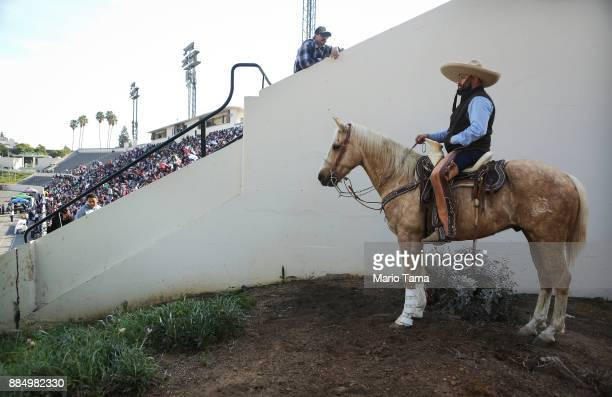 A man waits for Mass to begin atop a horse during the 86th Annual Procession and Mass in honor of Our Lady of Guadalupe in the traditionally Hispanic...