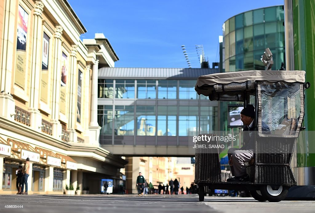 A man waits for passengers to ride on his 'push cab' along the boardwalk in Atlantic City New Jersey on November 8 2014 For decades Atlantic City was...