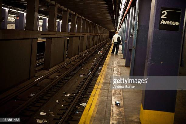 A man waits for the New York subway prior to the arrival of Hurricane Sandy on October 28 2012 in New York United States New York plans on shutting...