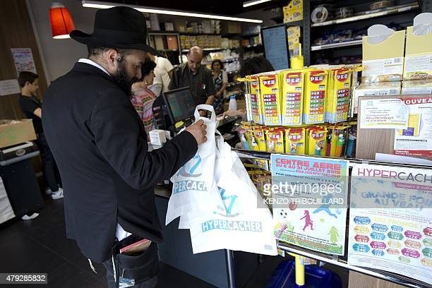 A man waits in line at a Hypercacher kosher supermarket in Paris on June 26 six months after a bloody hostage drama during a jihadist attack in...
