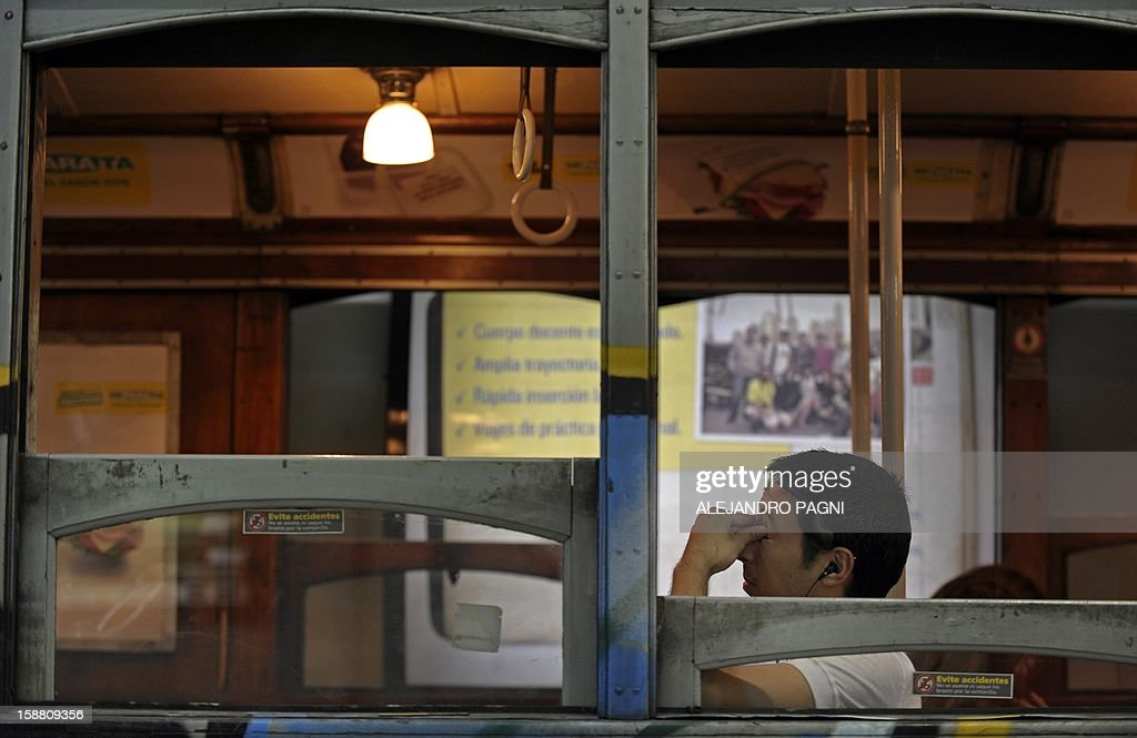 A man waits in one of the historic wagons La Brugeoise at the station Plaza de Mayo, part of the subway Line A which is expected to be close soon following a decision by city mayor Mauricio Macri to replace the line's fleet with Chinese-made wagons, in Buenos Aires, on December 29, 2012. Line A was the first subway line to work in the southern hemisphere and its trains are among the ten oldest still working daily. The La Brugeoise wagons were constructed between 1912 and 1919 by La Brugeoise et Nicaise et Delcuve in Belgium.