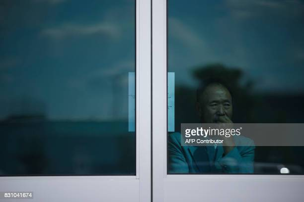A man waits inside the Light Korean Presbyterian Church in Mississauga Canada for the arrival of the church's pastor Hyeon Soo Lim on August 13 2017...