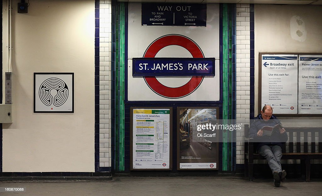 A man waits near artwork by Mark Wallinger on the platform of St James's Park Station as part of London Underground's largest ever art commission on February 7, 2013 in London, England. Mr Wallinger has been commissioned to produce artworks in all 270 stations on the Underground network to celebrate the 150 year anniversary of the tube opening.