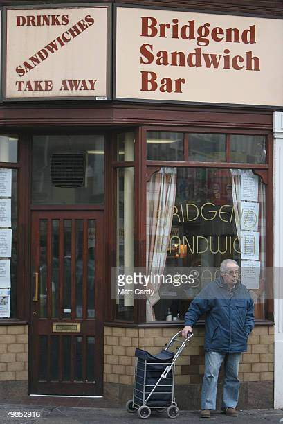 A man waits outside a cafe in Bridgend town centre following the 17th suicide in the local Bridgend area over the last thirteen months on February 20...