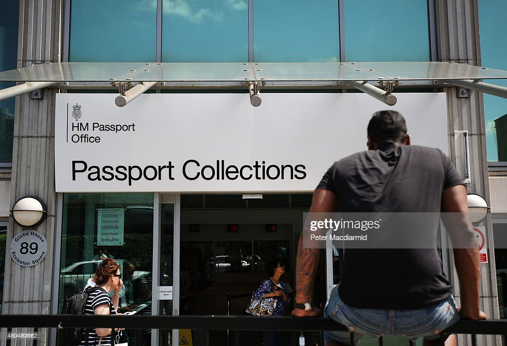 A man waits outside the passport office collections office on June 12, 2014 in London, England. Home Secretary Theresa May has announced extra measures to clear a backlog of passport applications.