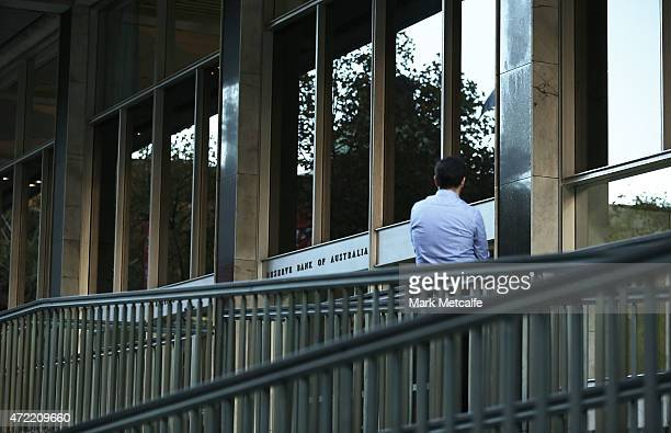 A man waits outside the Reserve Bank of Australia headquarters on May 5 2015 in Sydney Australia Forecasters are predicting the Reserve Bank of...