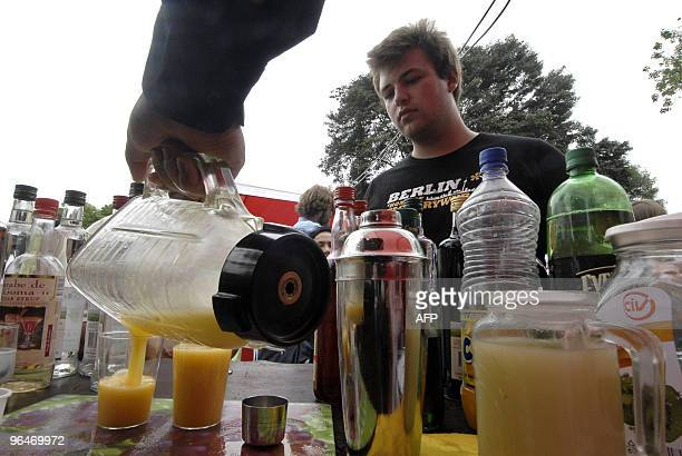 A man waits to be served a 'passion fruit sour' a version of the Peruvian traditional cocktail pisco sour during the celebration of the Pisco Sour...