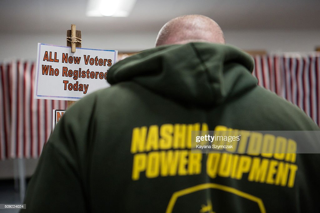 A man waits to register to vote at the First Baptist Church on primary day, February 9, 2016, in Nashua, New Hampshire. Tuesday is the 100th anniversary of the New Hampshire primary, the 'First in the Nation' test for presidential candidates from both parties.
