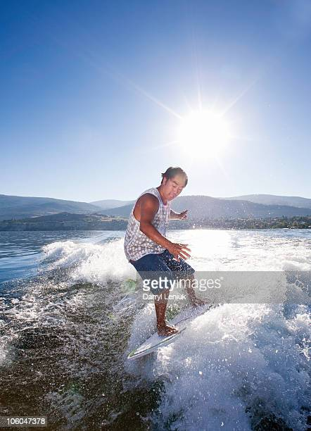 Man wake surfing.