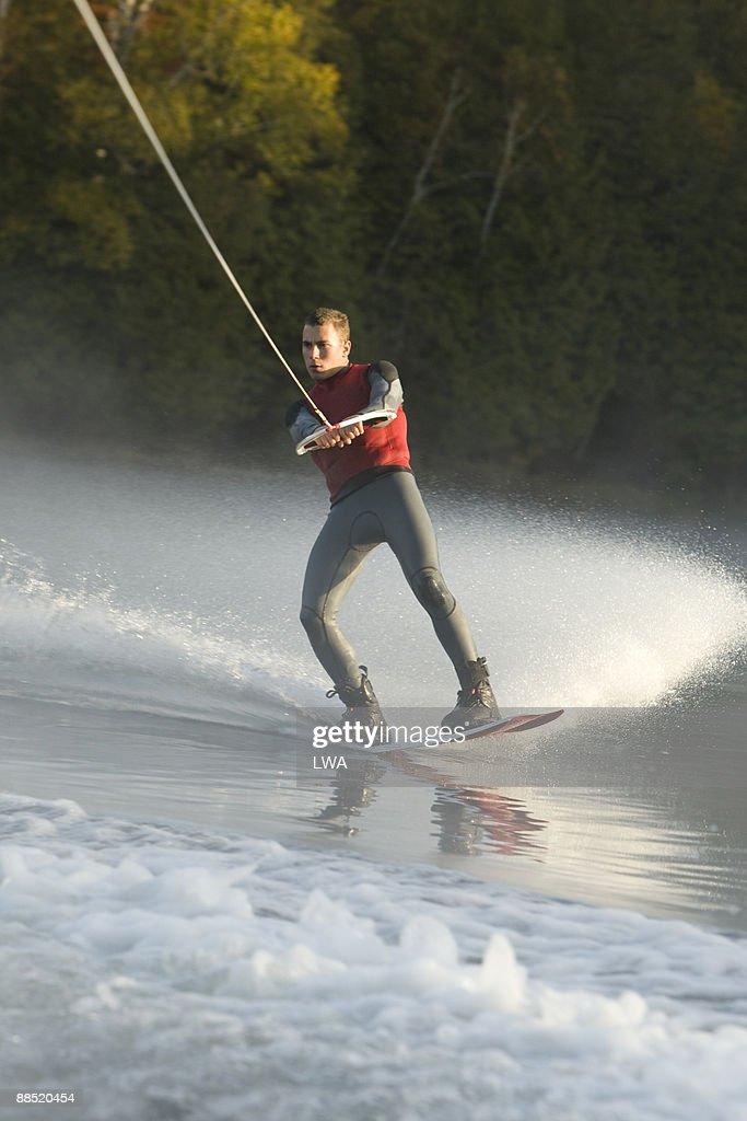 Man Wakeboarding On Lake : Stock Photo