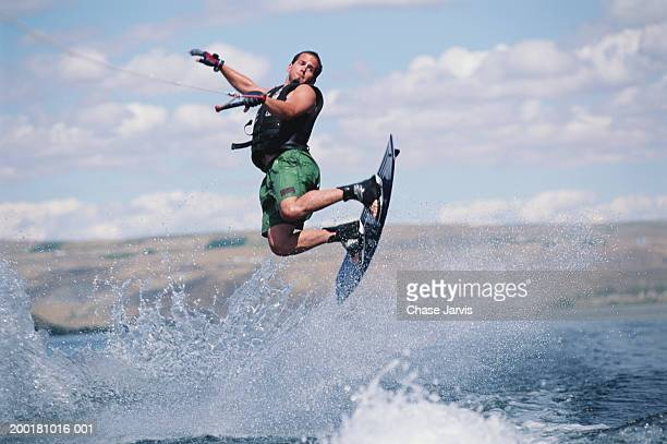 Man wakeboarding, view from boat