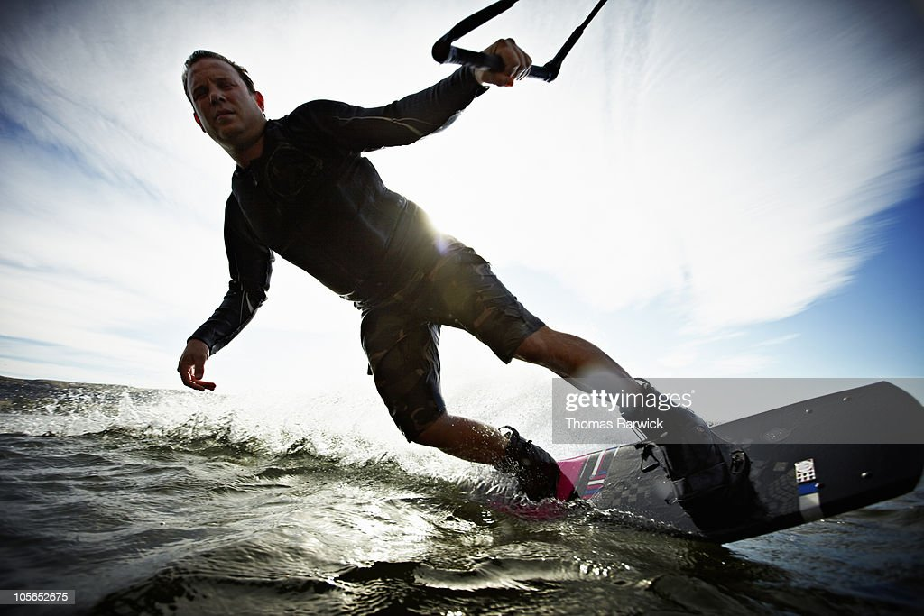 Man wakeboarding view from water : Stock Photo