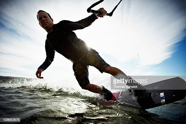Man wakeboarding view from water