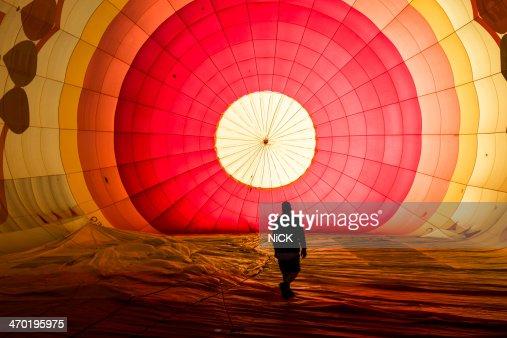A man walk in the balloon in sunrise
