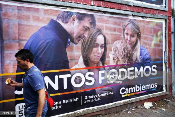 A man walk past a campaign poster for candidate Esteban Bullrich displayed on a wall in the Hurlingham neighborhood of Buenos Aires Argentina on...