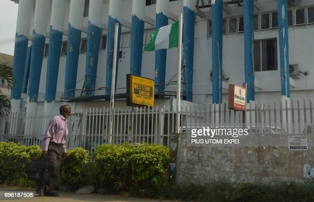 A man walk past Western Union money transfer and Moneygram in a branch of bank where beneficiaries collect money in foreign currencies repatrated by...