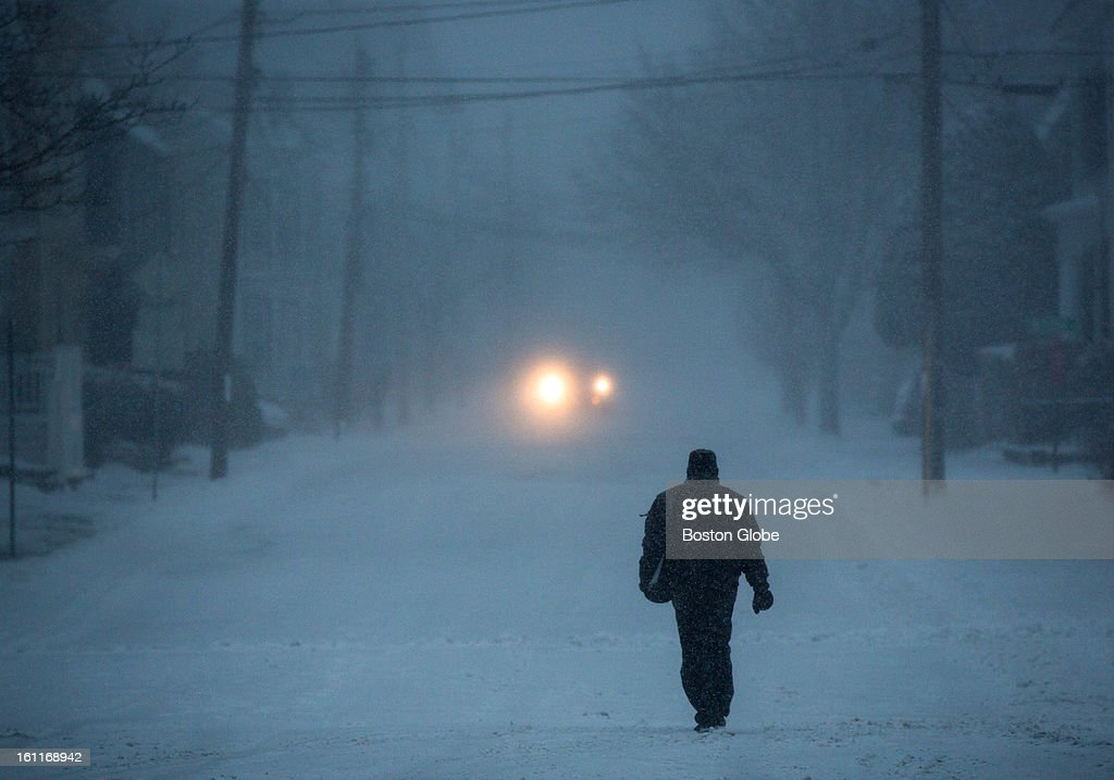 A man walked along Washington Street as a winter storm, expected to dump as much as 24 inches of snow in the region, intensified in Newburyport.