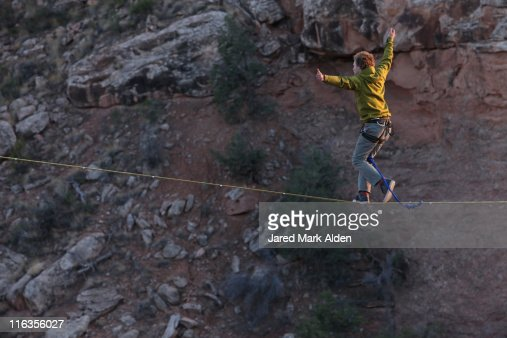 A man walking a two hundred thirty foot plus highline in Moab, Utah.