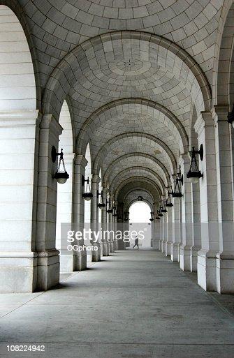 Man walking across passage