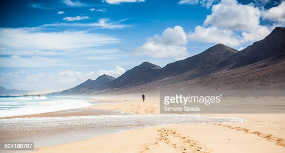 Man walking alone on Playa de El Cofete