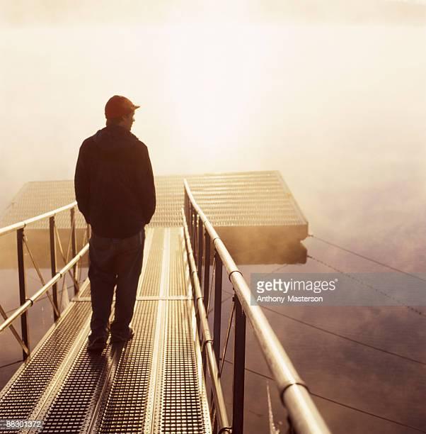 Man walking along dock
