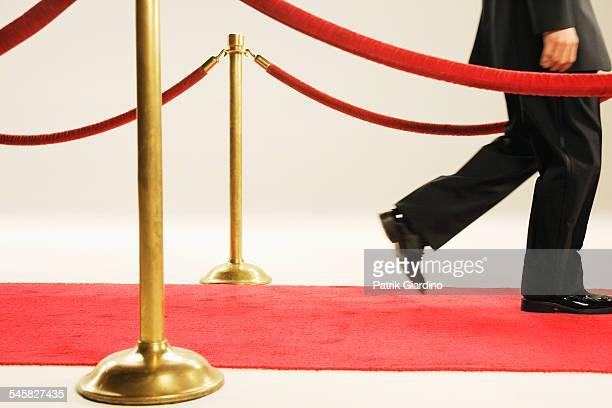 Man Walking Along Red Carpet