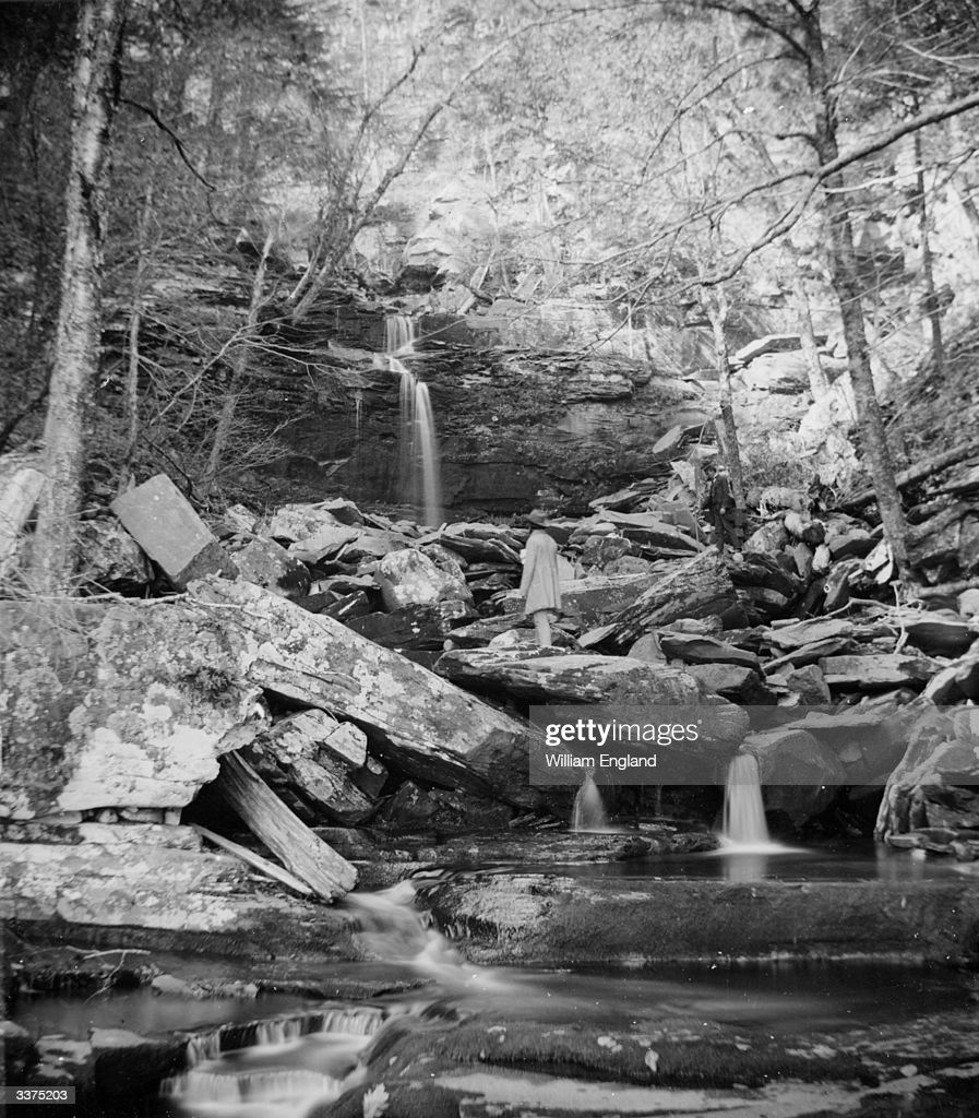 A man walking at Kaaterskill Clove in the Catskill Mountains New York