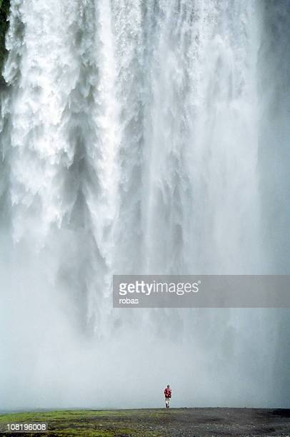 Man walking at the Skogafoss, Iceland
