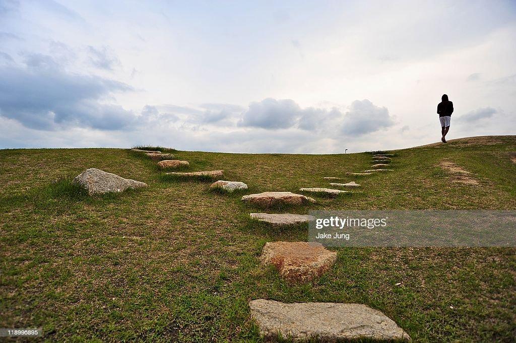 Man walking at top of forking rock