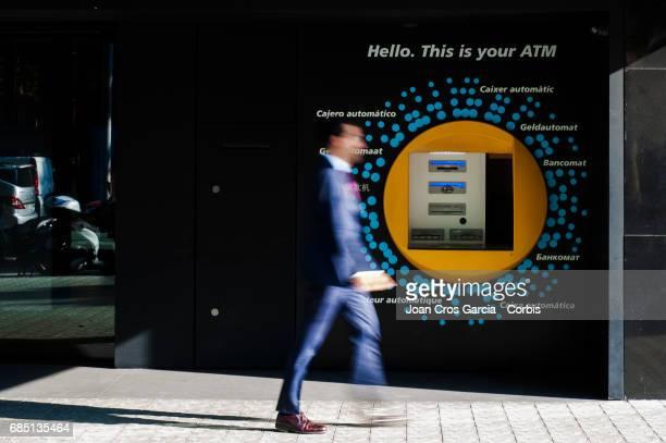 A man walking by a Caixa Bank office on May 17 2017 in Barcelona Spain 'n'n