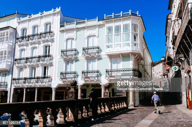 MONDOñEDO LUGO GALICIA SPAIN Man walking by beautiful buildings and cobbled street in Cathedral square
