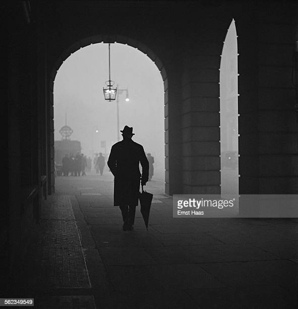 A man walking by the Ritz Hotel on Piccadilly London circa 1953