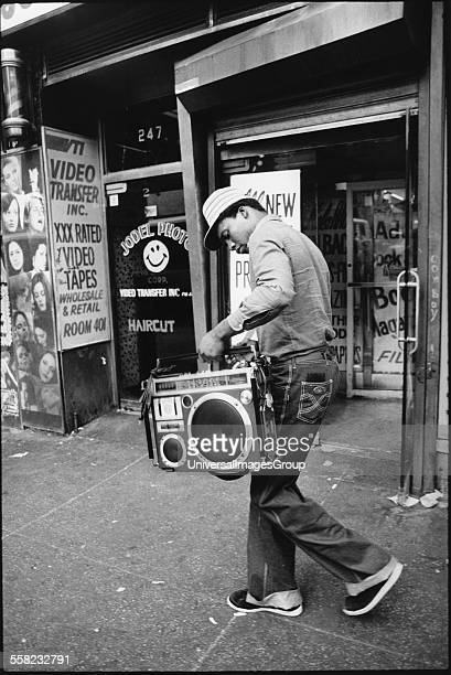 Man walking down the street with his ghetto blaster in his hands New York USA 1980