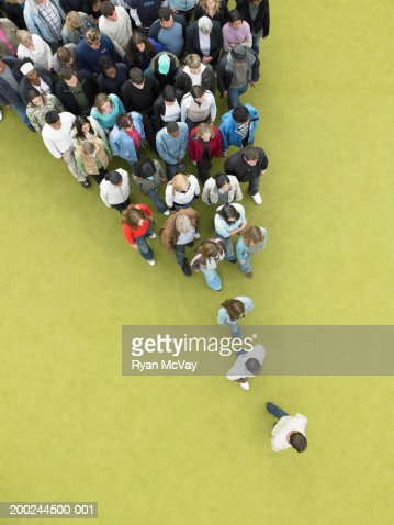 Man walking, followed by gradually increasing crowd, overhead view