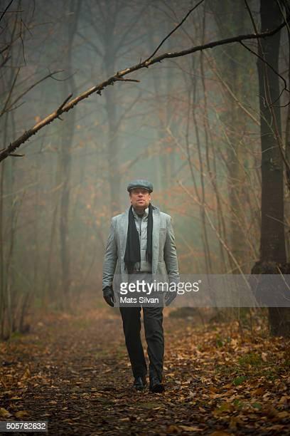 Man walking in a foggy forest