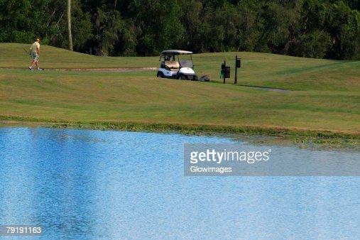 Man walking in a golf course : Foto de stock