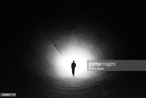 Man walking in Cardboard tunnel