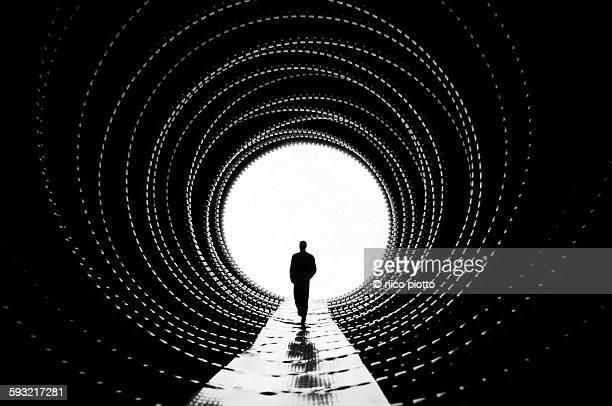 Man walking in corrugated plastic tunnel