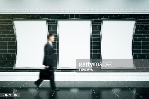 Man walking in front of posters : Stock Photo