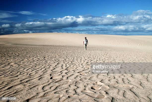 Man walking in Fuerteventura Desert