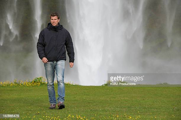 Man walking in grassy field