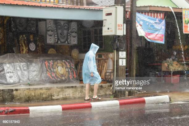 Man walking in heavy rain, Patong Beach, Phuket Thailand 2017