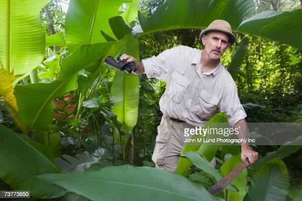 Man walking in jungle