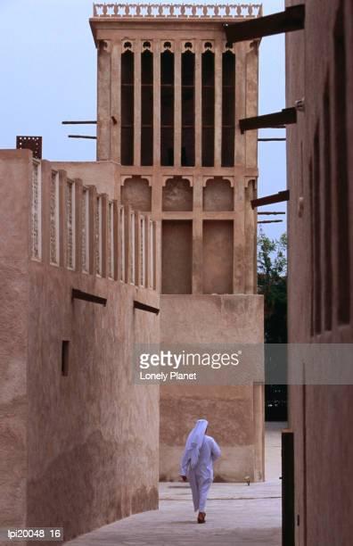Man walking in lanes of Bastikia quarter.