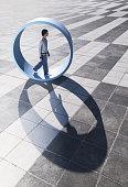 Man walking in large wheel outdoors