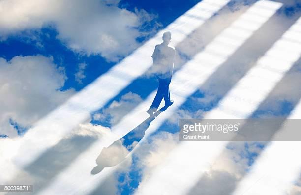 Man walking in light rays