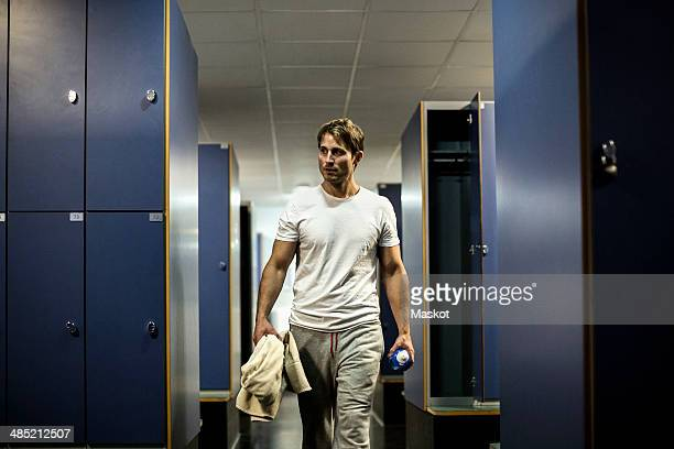 Man walking in locker room of health club