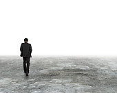 Man walking in the mist on dirty concrete floor