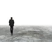 Man walking in the mist on dirty concrete floor